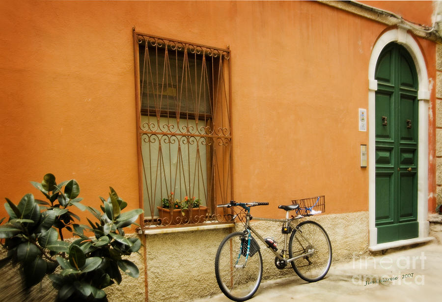 Bicycle Leaning Against Orange Building With Green Door In Italy Photograph - The Green Door by Jim  Calarese