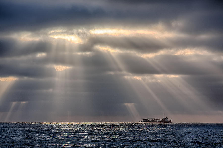 Beach Photograph - The Guiding Light by Peter Tellone