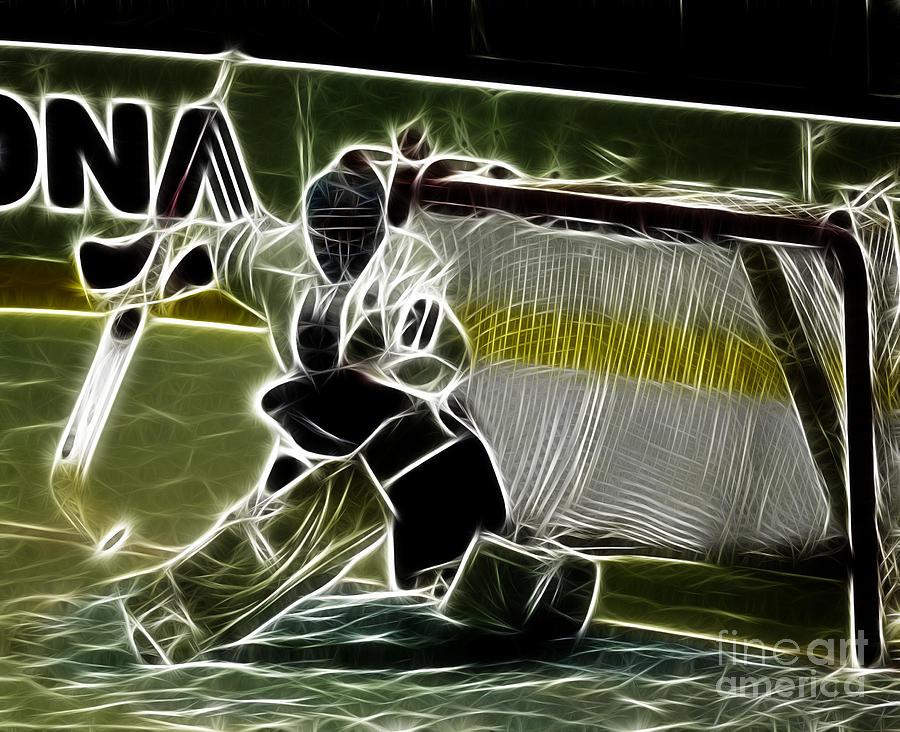 Hockey Photograph - The Hockey Goalie by Bob Christopher