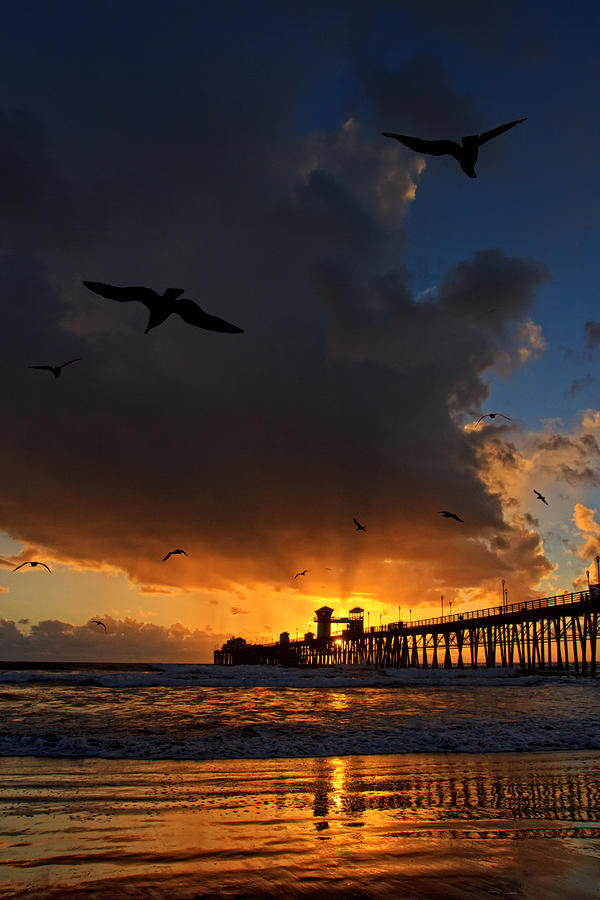 Oceanside Photograph - The Jutting Pier At Sundown  by Donna Pagakis