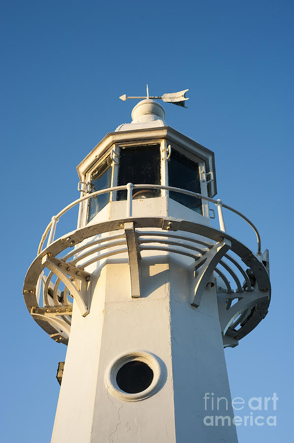 Autumn Photograph - The Lighthouse At Mevagissy by Anne Gilbert