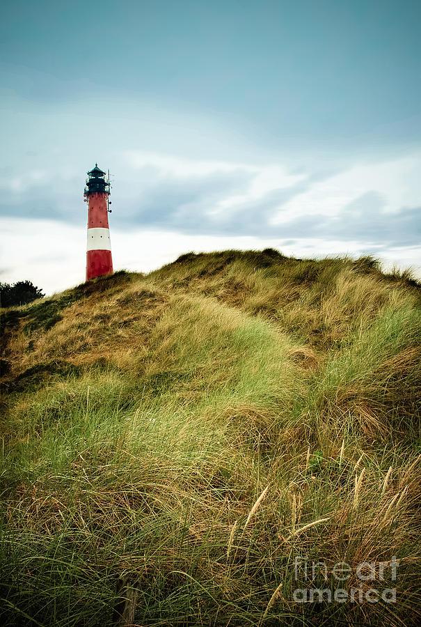 Beach Grass Photograph - the lighthouse of Hoernum by Hannes Cmarits