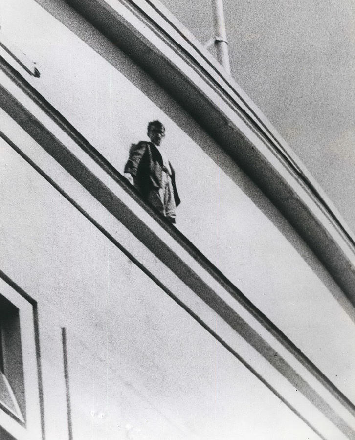 Retro Photograph - The Man In Love Is Saved From A Parapet by Retro Images Archive