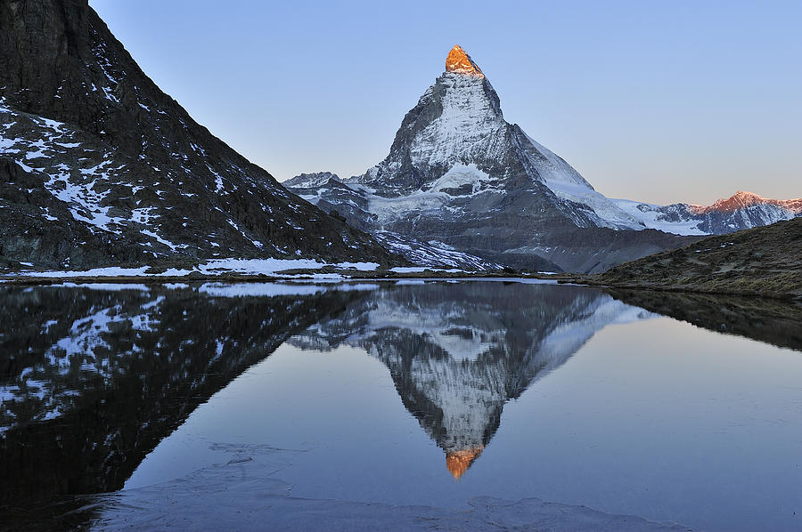 The Matterhorn And Riffelsee Lake Photograph by Thomas Marent