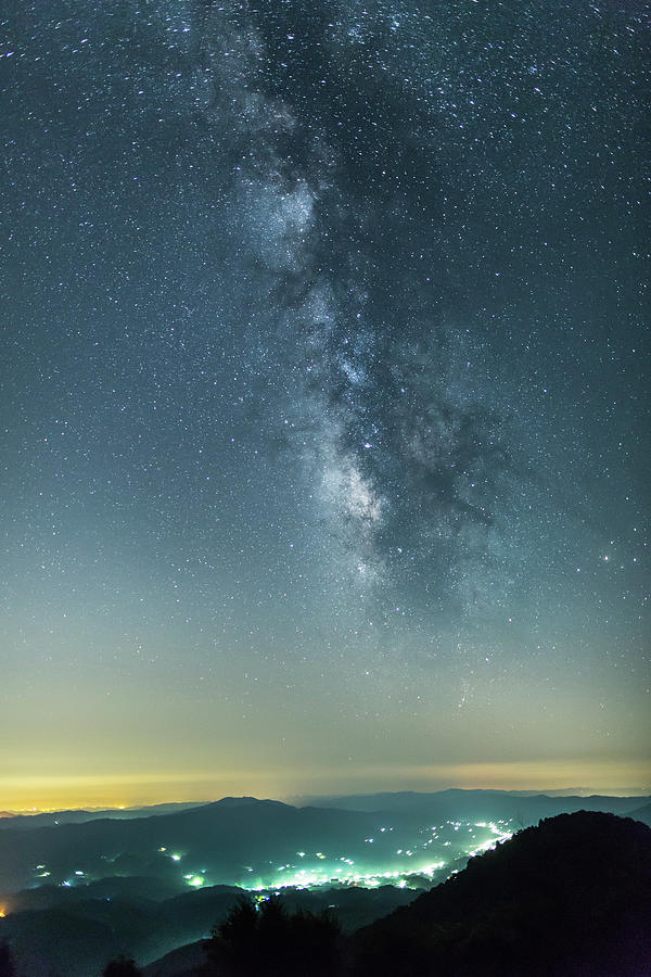 The Milky Way Hovering Above A Town Photograph by Trevor Williams