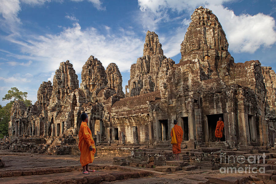 Cambodia Photograph - The Monks Of Bayon by Pete Reynolds