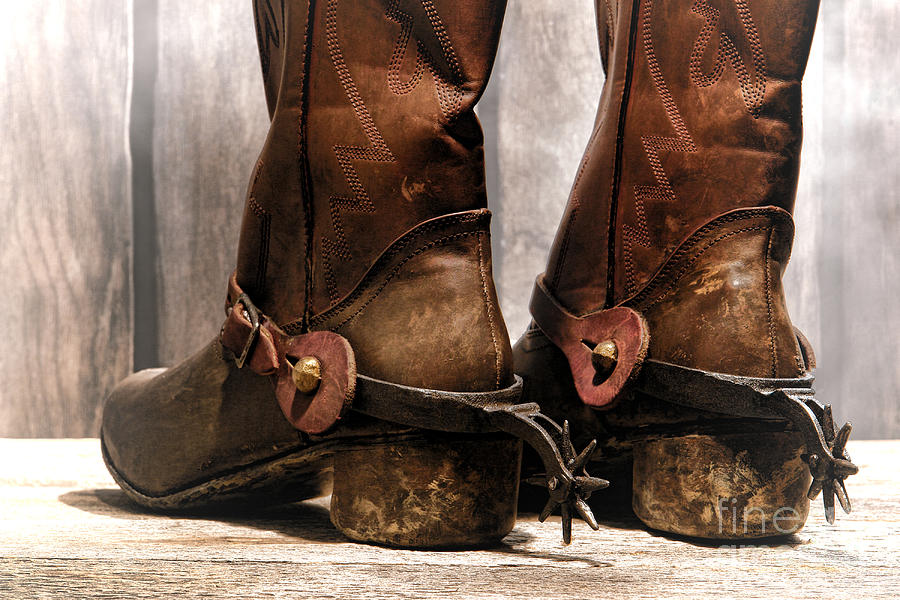 Cowboy Photograph - The Muddy Boots by Olivier Le Queinec