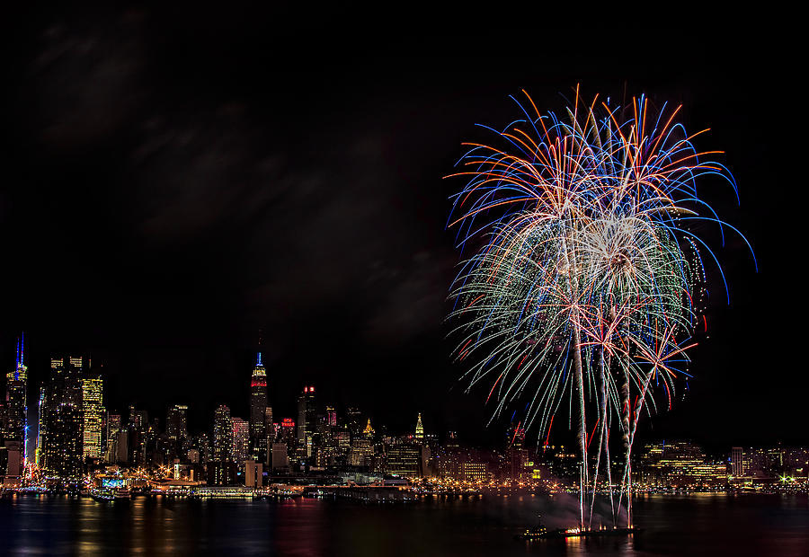 4th Of July Photograph - The New York City Skyline Sparkles by Susan Candelario
