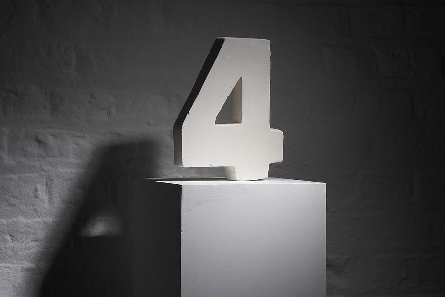 The number four as sculpture on a pedestal Photograph by Laurence Dutton