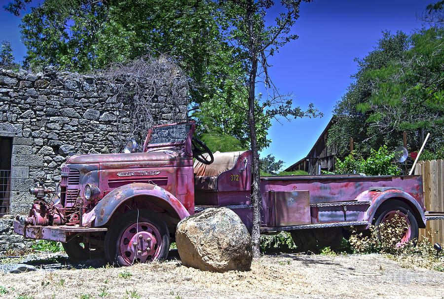 Firetruck Photograph - The Old Firetruck by Wayne Wilton