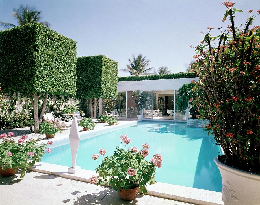 Architecture Photograph - The Pool And Garden Of A Home by William Grigsby