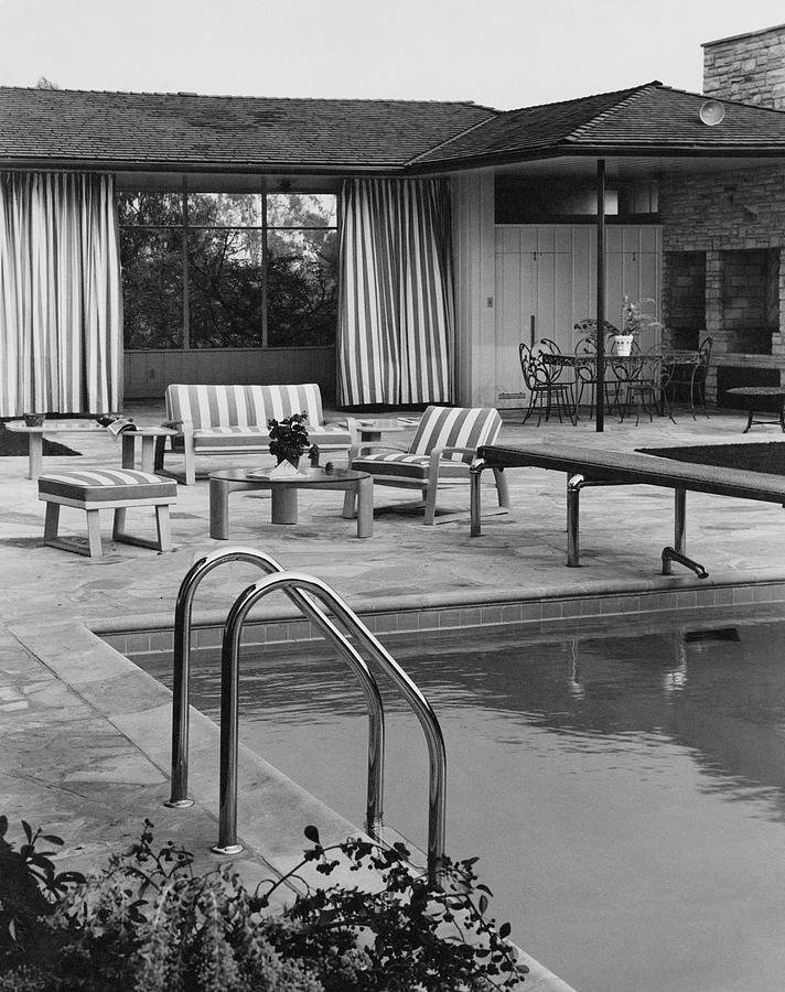 The Pool And Pavilion Of A House Photograph by Sharland