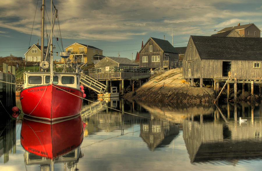 The Red Boat at Peggys Cove by Rob Huntley
