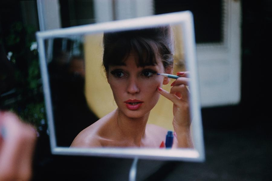The Reflection Of A Model Applying Make-up Photograph by Karen Radkai
