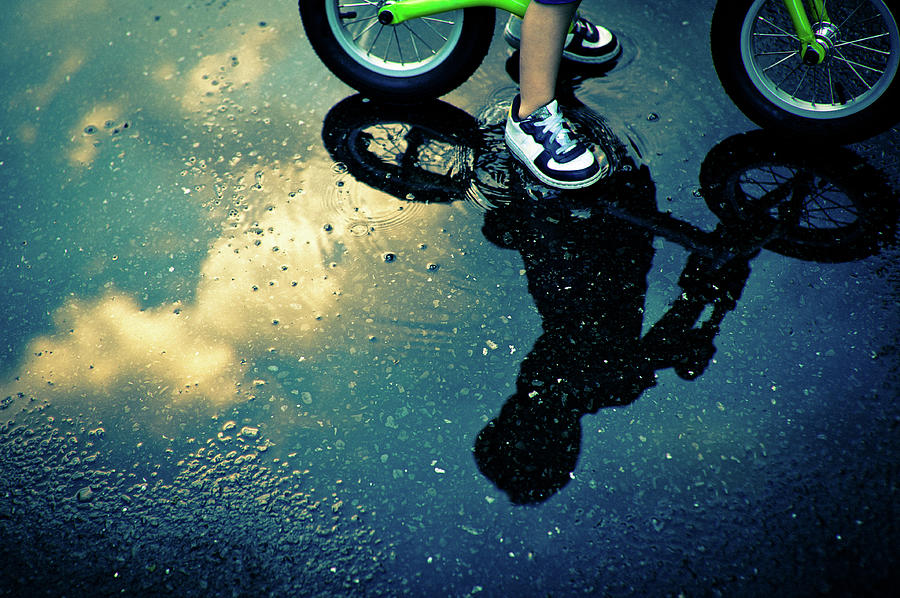 The Reflection Of The Little Boy Riding Photograph by Clover No.7 Photography