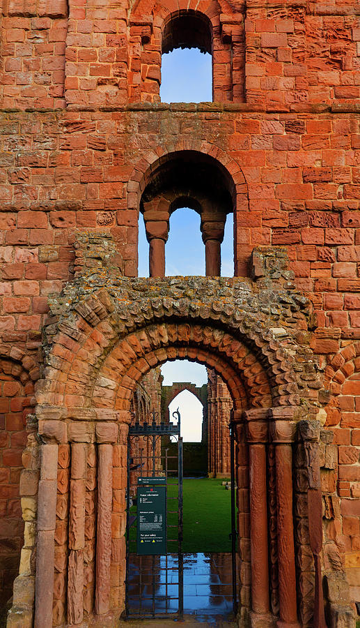 Vertical Photograph - The Romanesque Doorway In The Monastery by Panoramic Images