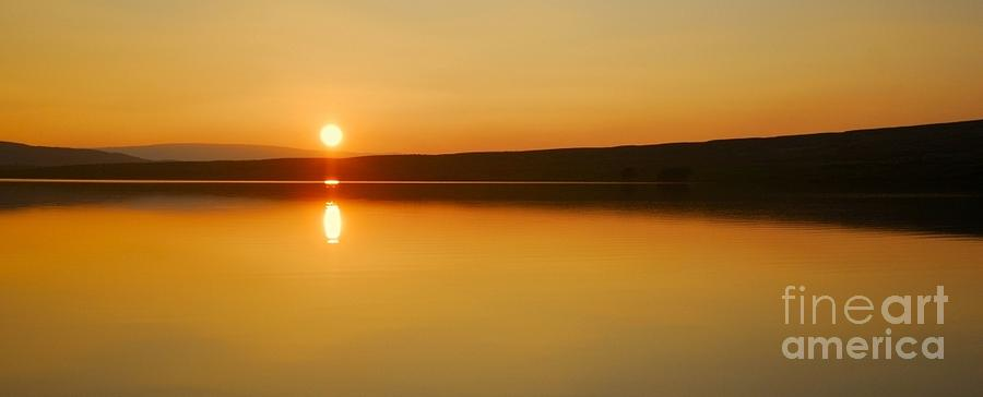Sunset Photograph - The Setting Of The Sun by John Kelly