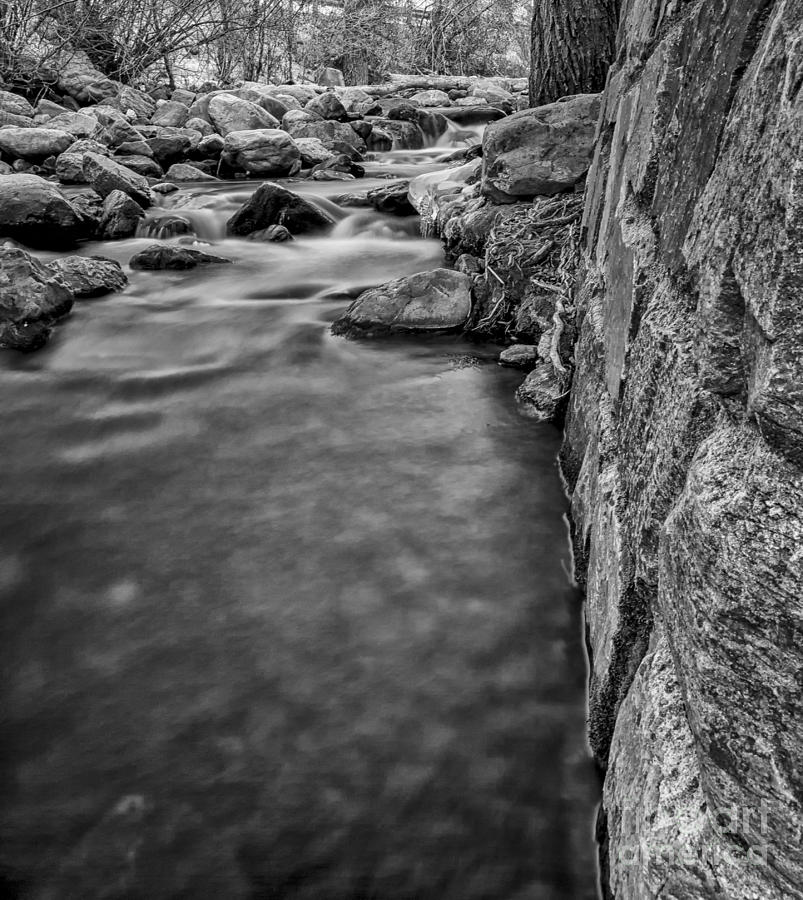 The Stone Wall Next To The River Bw Photograph