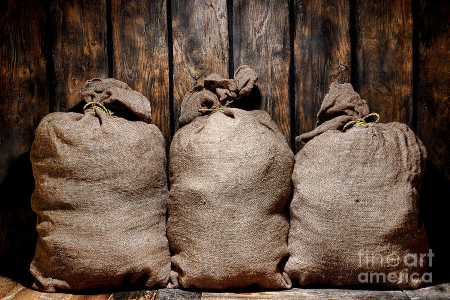 Burlap Photograph - Three Bags In A Warehouse by Olivier Le Queinec