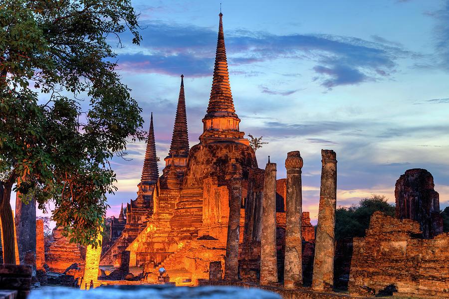 Three Illuminated Pagodas At Wat Phra Photograph by Fototrav