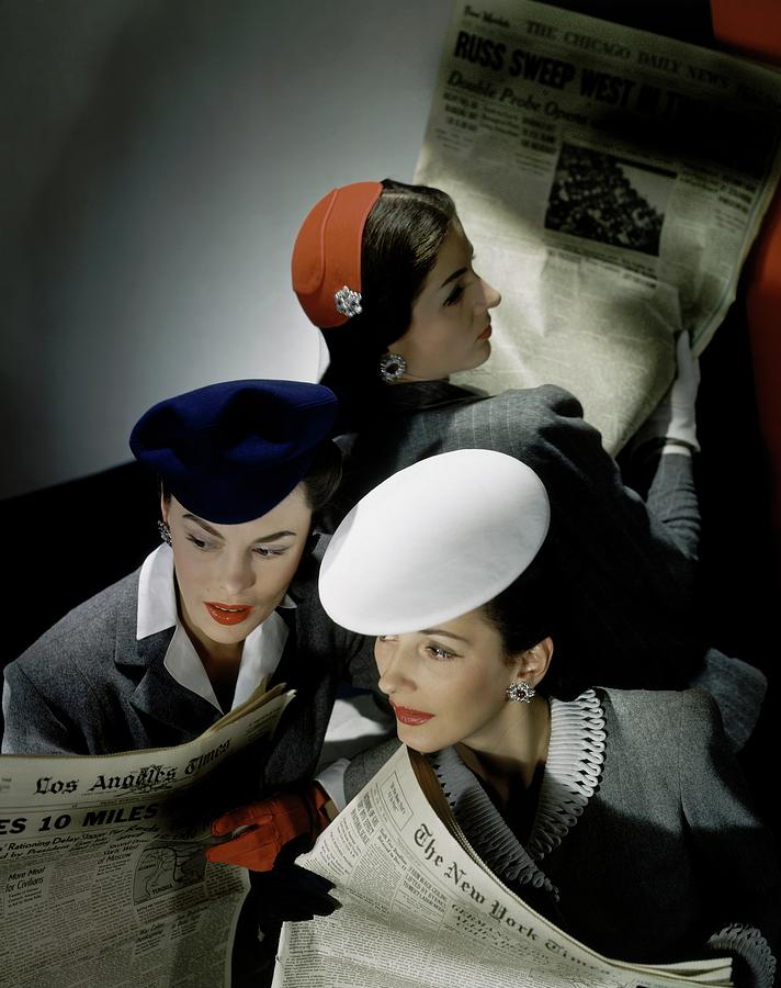 Three Models Wearing Assorted Hats Photograph by Horst P. Horst