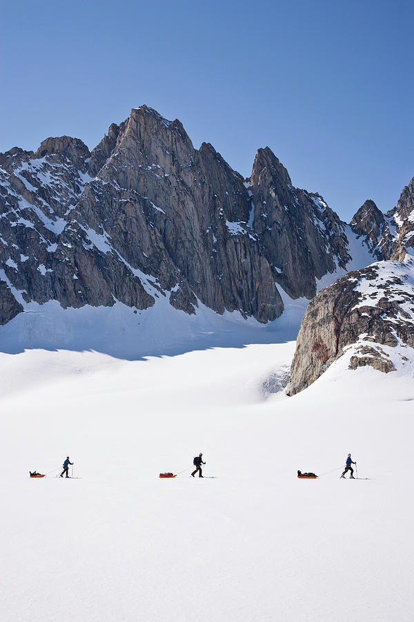 Adventure Photograph - Three People Ski-tour On Karale Glacier by Henry Georgi