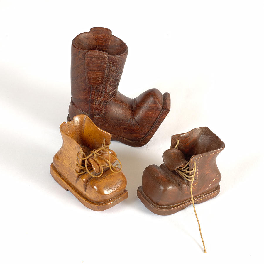 Three small boots carvings photograph by michael flood