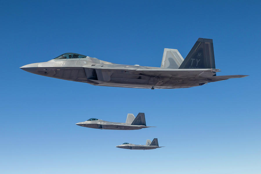 Three U.s. Air Force F-22 Raptors Photograph by Rob Edgcumbe/stocktrek Images