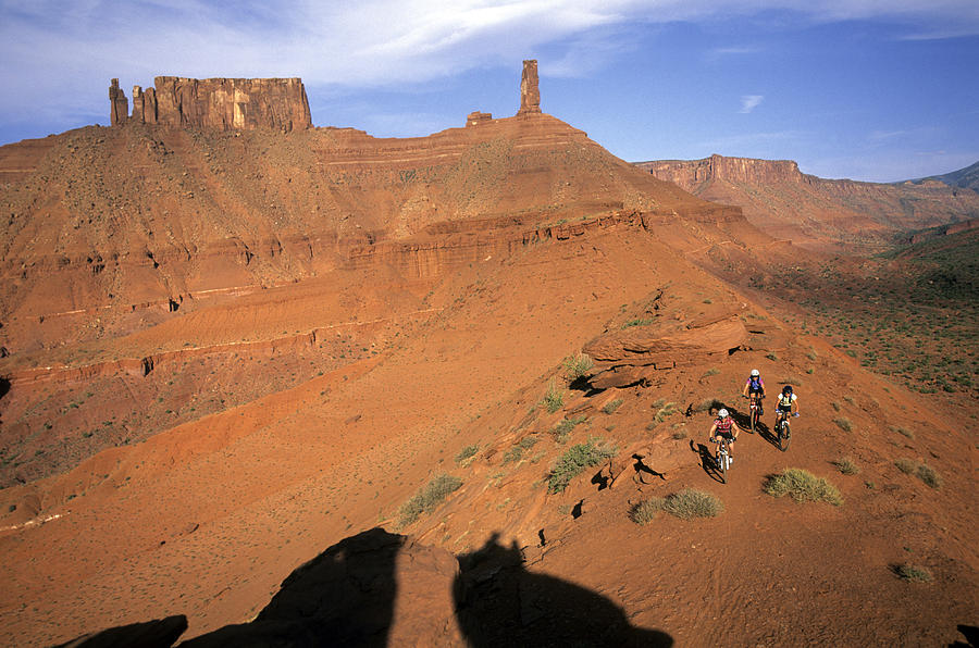 Above Photograph - Three Women Mountain Biking In Moab by Scott Markewitz