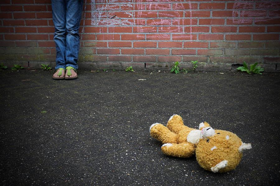 Thrown away Teddy bear Photograph by Zmeel