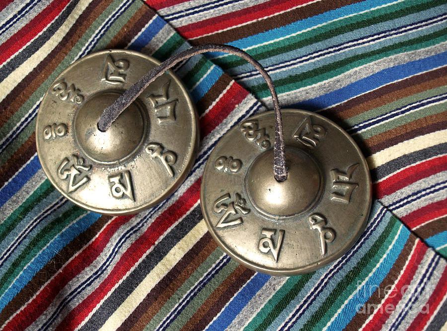 Tibetan Photograph - Tibetan Prayer Bells On Woven Scarf by Anna Lisa Yoder