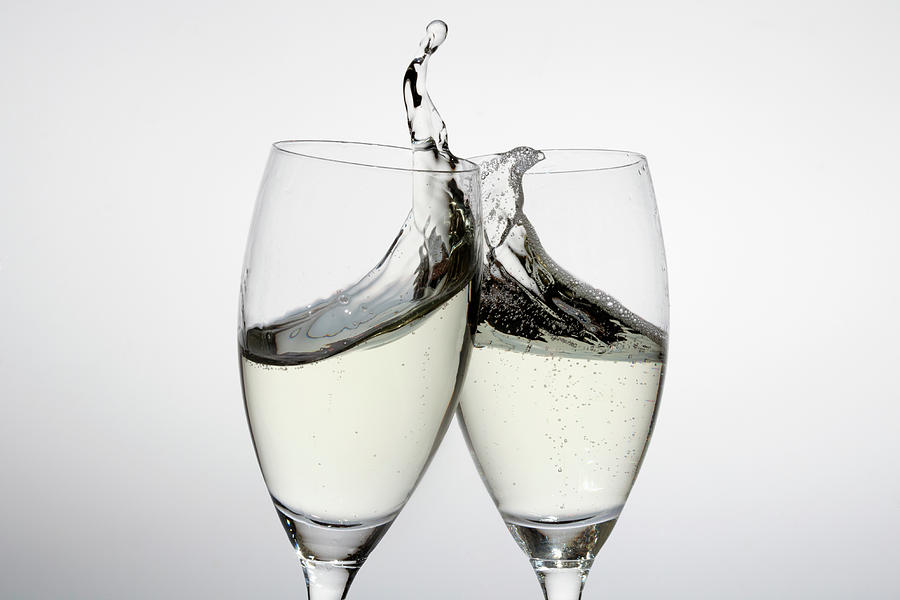 Toasting With Two Glasses Of Champagne Photograph by Dual Dual