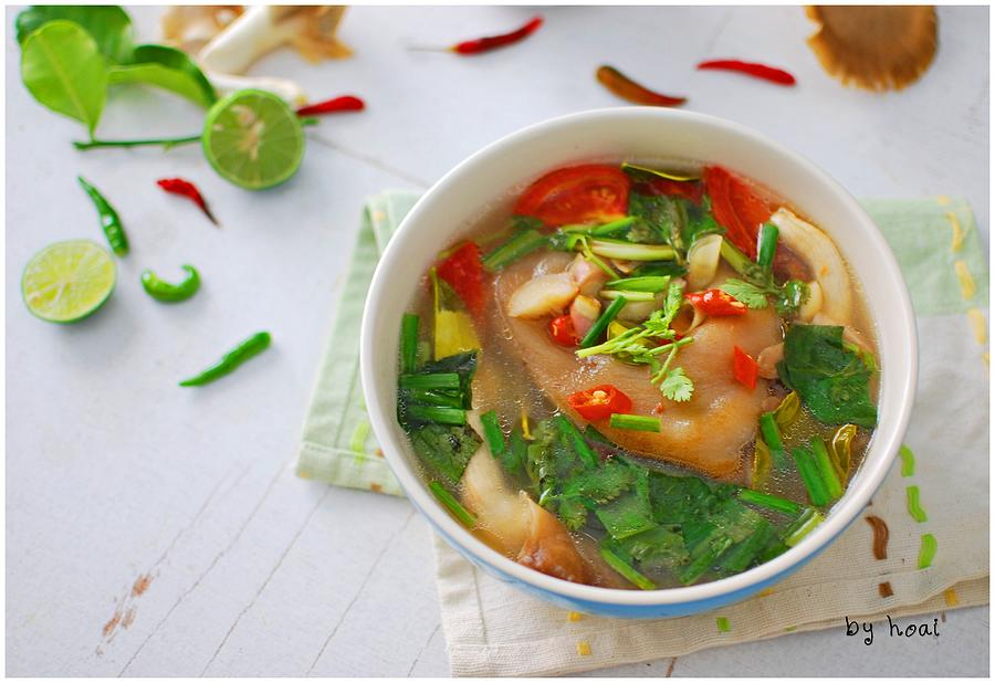 Tom Yum Pork Knuckle Photograph by Hoaixh