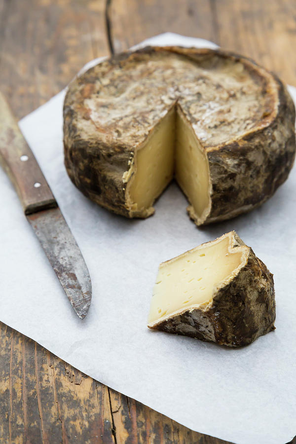 Tomme De Savoie Cheese And Knife On Photograph by Westend61