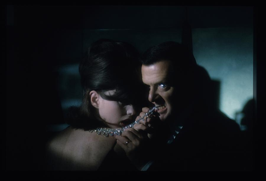 Tony Randall Biting A Cartier Necklace Photograph by Sante Forlano