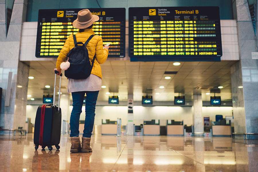 Tourist at Barcelona international airport Photograph by Martin-dm