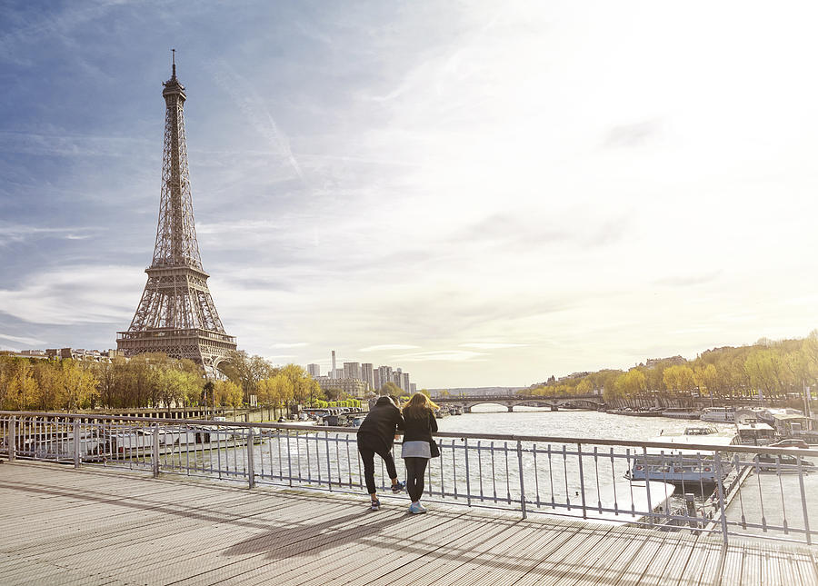 Tourist couple looking at The Eiffel Tower, Paris, France Photograph by James ONeil