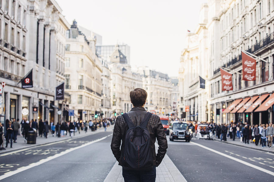 Tourist With Backpack Walking On Regent Street In London, Uk Photograph by Alexander Spatari