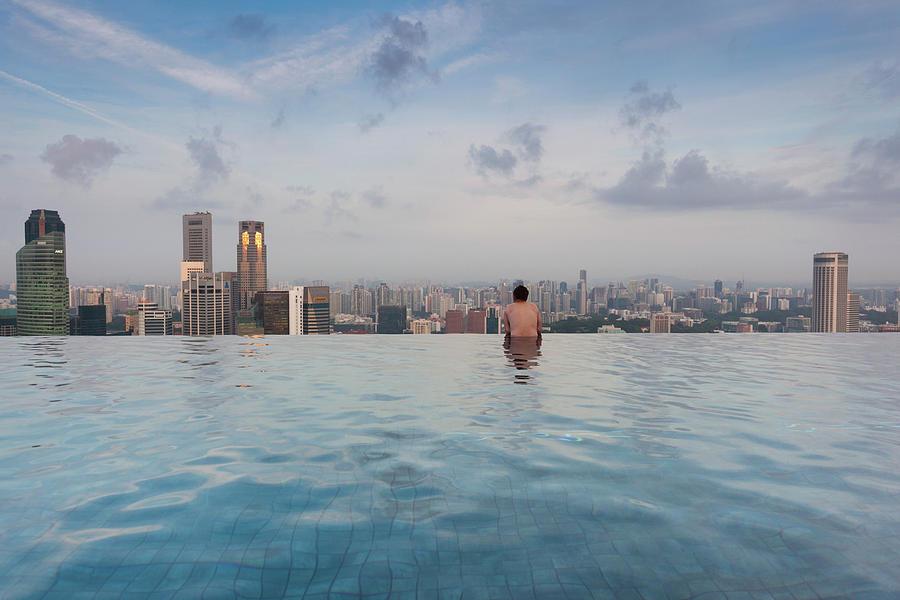 Horizontal Photograph - Tourists At Infinity Pool Of Marina Bay by Panoramic Images