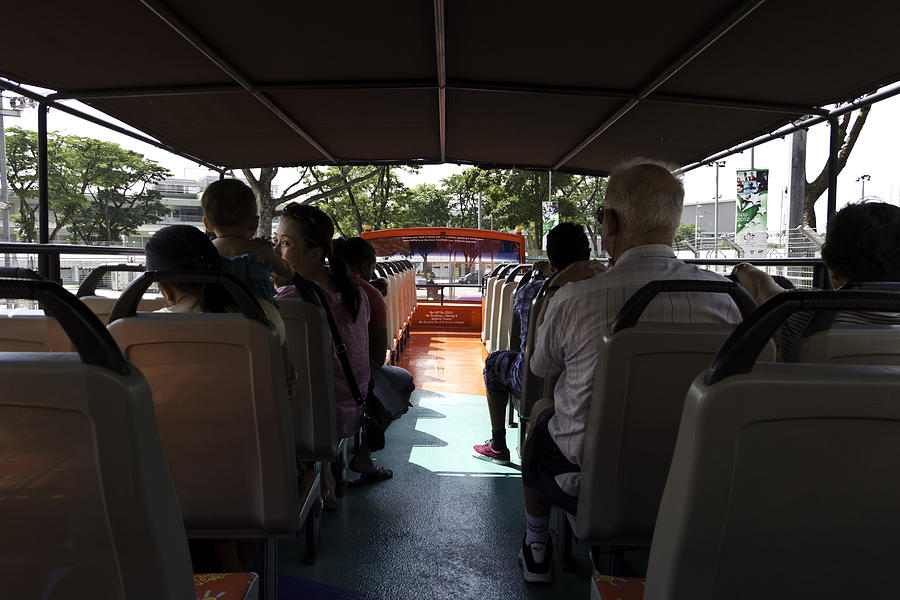 Asia Photograph - Tourists On The Sight-seeing Bus Run By The Hippo Company In Singapore by Ashish Agarwal