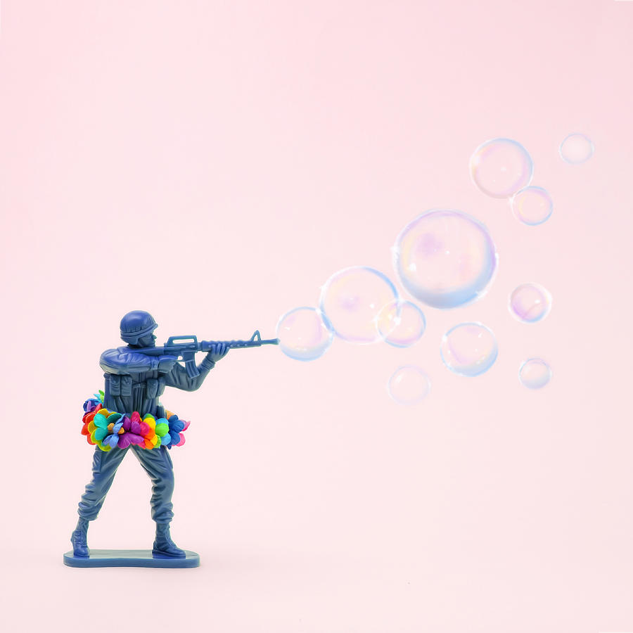 Toy Soldier Shooting Bubbles From Gun Photograph by Juj Winn