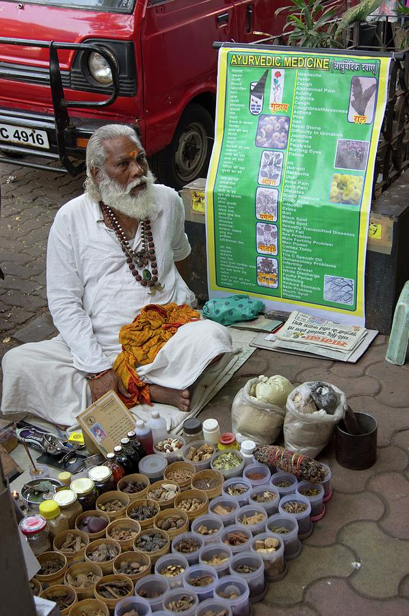Man Photograph - Traditional Indian Medicine Seller by Mark Williamson