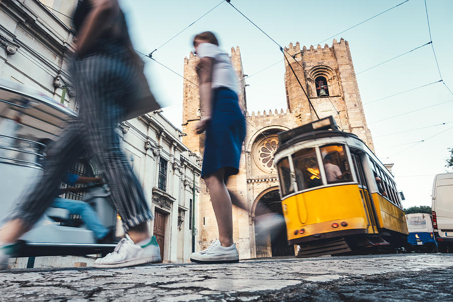 Traffic Around Lisbon Cathedral Photograph by Borchee