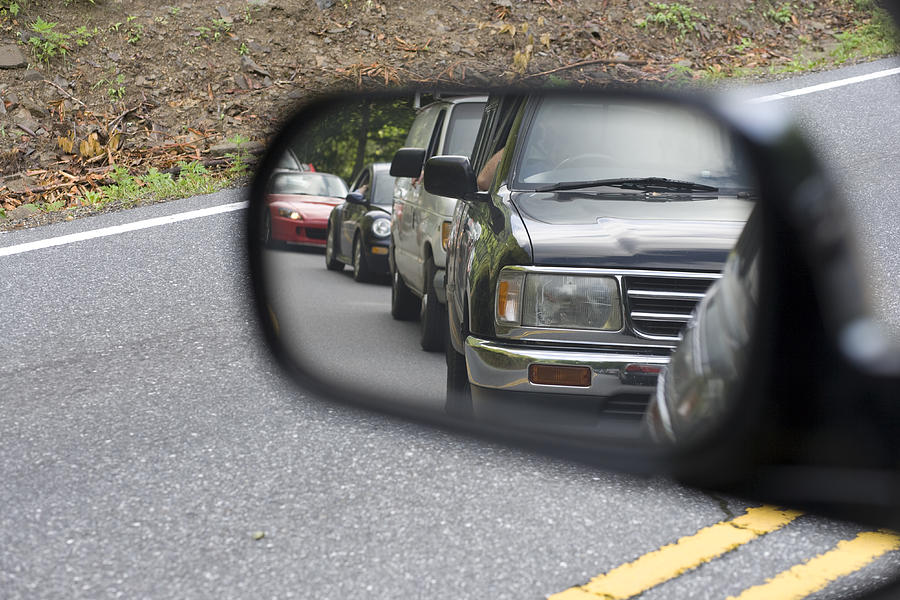 Traffic in the rear view mirror Photograph by Wbritten