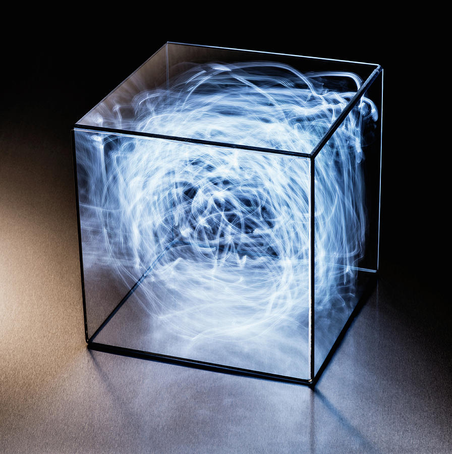 Trails Of Blue Light In Clear Box Photograph by Pm Images
