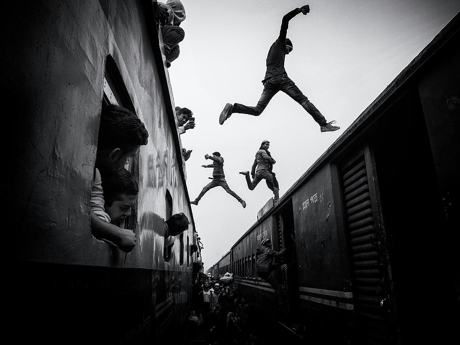 Action Photograph - Train Jumpers by Marcel Rebro