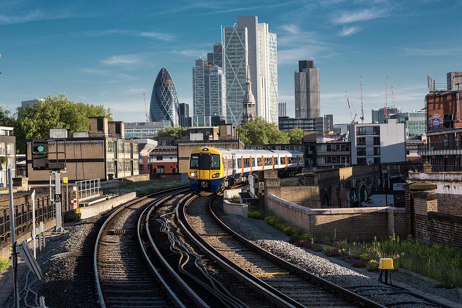 Train Leaving The City, London Uk Photograph by Tim E White