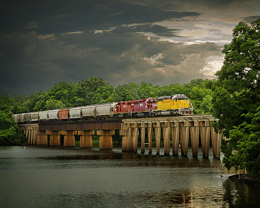 Train on a Stormy River Evening by Randy Forrester