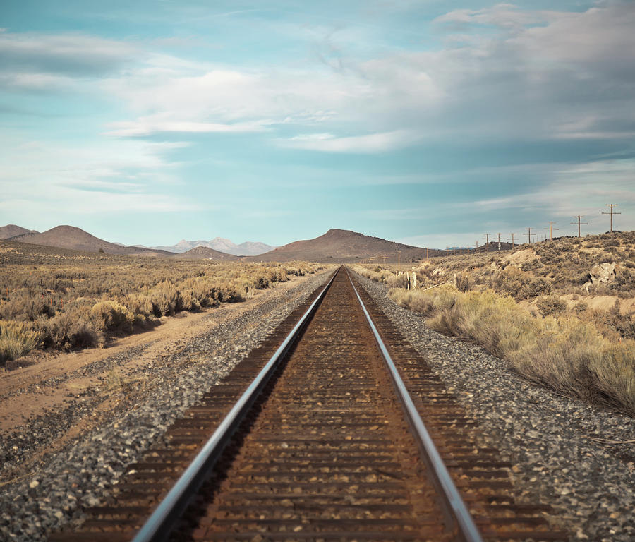 Train Tracks In The Desert Photograph by Harpazo hope
