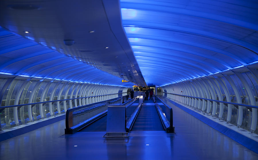 Travelator, moving walkway, blue lighting Photograph by Onfilm